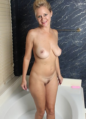 Busty blonde Heidi Gallo slips  a pink dildo into her tight mature box