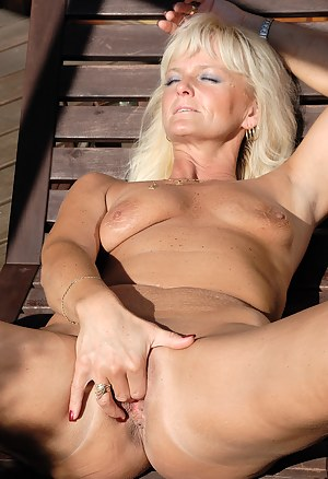 43 year old blonde Jenny F slips her long purple dildo deep inside