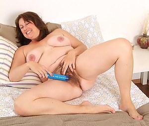 BBW Marishka enjoys her long blue toy in this gallery
