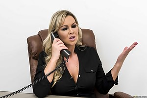 She's talking on the phone, asking this guy to take a seat over there. Now she's gonna let him suck on her nipples and lick her pussy.