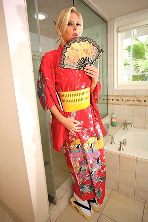 Lovely blonde is looking so sexy wearing Asian uniform. She is masturbating and fucking with her powerful boyfriend in the shower.