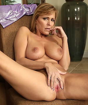 Blonde MILF stripped and rubbed her mature pussy until she climaxed