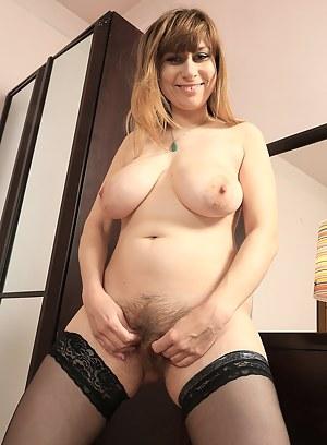 Hairy pussied 34 year old Marina slips off her panties to reveal bush