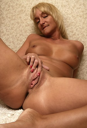44 year old blonde Barbie slips a few finger into her shaven mature hole
