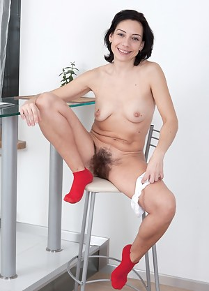Perky and pretty, Eva is the perfect hairy girl because, well, she's hairy! As soon her pants are off you can see her hairy mound poking through her cotton panties, waiting to be stroked.