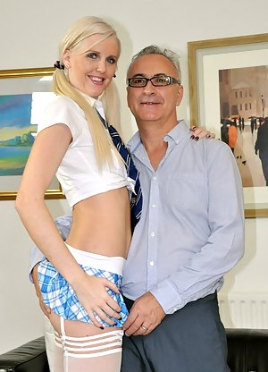 Blonde girl wearing a schoolgirl outfit fucks an old dude