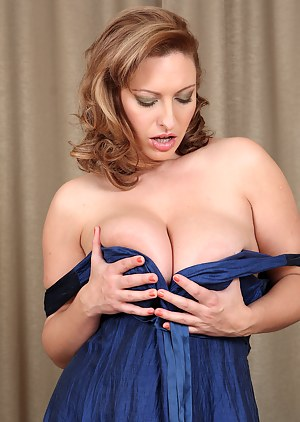 Elegant 30 year old Salinas slips off her dress and shows big tits