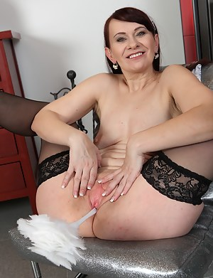 Mature maid Vera Delight strips and slides her feather duster deep