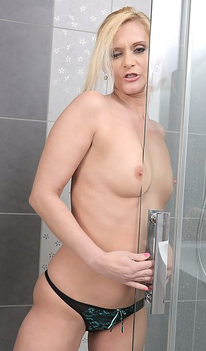 Cute blonde 44 year old Starlet getting herself pussy off in the shower
