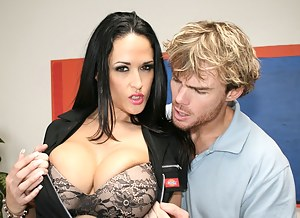 Powerful man is banging this adorable brunette in black stockings on the orange sofa. He is also jizzing massively deep into her ass hole.