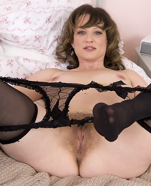 Misty is waiting for you on her bed. Wearing her sexy black lingerie and red corset, she is ready for a hairy adventure. She will leave you breathless!