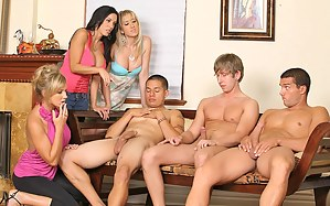 Big cocks are ready for fucking. Watch beautiful babes enjoy a wild group sex with two handsome studs while their cocks are in holes.