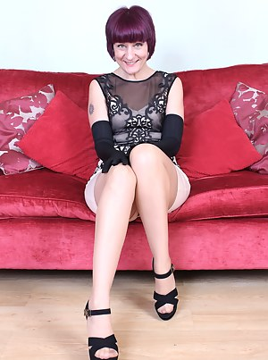 Naughty British housewife playing on the couch