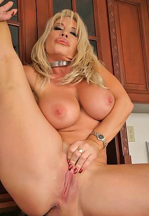 Jenna Lynn exposes her formidable fake tits while does an excellent boobjob to her lover and gets pounded by his big cock on the kitchen.
