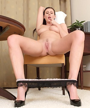 Horny MILF Lara Latex takes a break to spread her legs wide for us