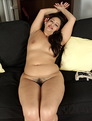 Elegant 36 year old Milli strips off her dress and spreads her beaver