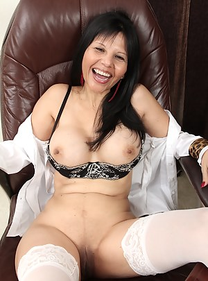 Exotic mature babe Marcy Darling spreads her pussy.