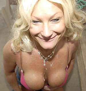 Blonde big titted mature slut takes it all in