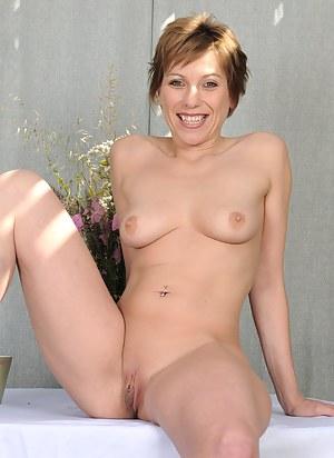 Redheaded MILF Brandi Minx shows off her mature shaven pussy