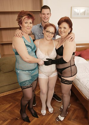 Three horny mature sluts sharing one hard younger cock