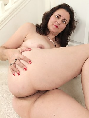 Curvy wife Gianna Jones spreads her hairy pussy.
