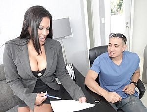 Extraordinary seduction story in the office features a splendid brunette with big tits and her gorgeous coworker while boss is out.