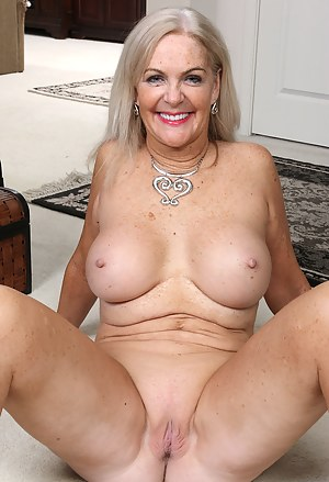 58 year old housewife Judy Mayflower spreading wide in the livingroom