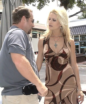 Wonderful woman is looking great wearing her sexy dress. This man wants to penetrate her holes, and she lets him do it in hardcore manner.