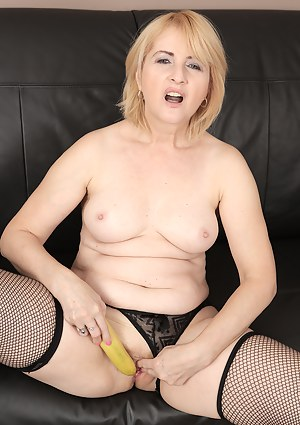 Horny busty blonde Jennyfer B uses a banana for pleasure