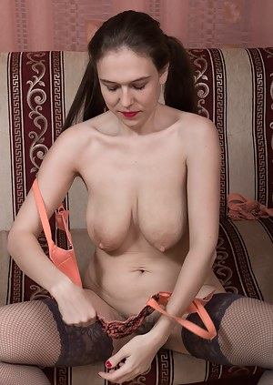 Agneta lays back reading a book and is wearing stockings and lingerie. Up her skirt we can see her sexy hairy pussy. The denim skirt and stockings fly off and she shows her 38C breasts and hairy pussy.