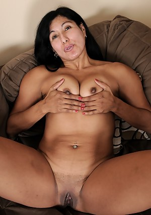 Exotic and mature Estrella Jane spreading her firm ass wide open