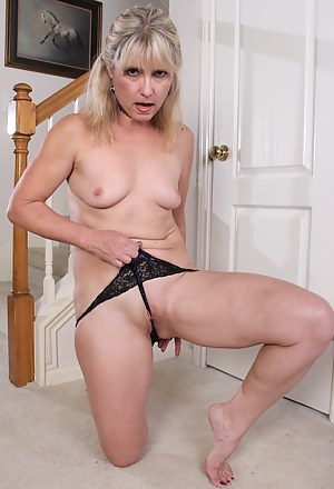 Older amateur Rebecca Hill spreads her shaved pussy.