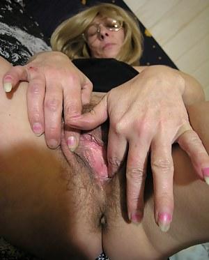 Horny mature slut showing us her wet cunt