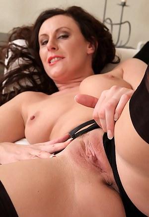 Long legged brunette MILF Lara Latex sporting hot black lingerie