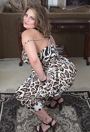 Horny wife Cherrie Dixon exposes her big mature tits.