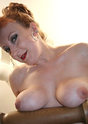 Hot red mature nympho playing with her toys