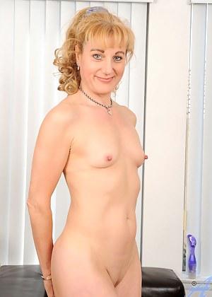 Anilos Angella Faith reveals her big nipples and tasty milf pussy