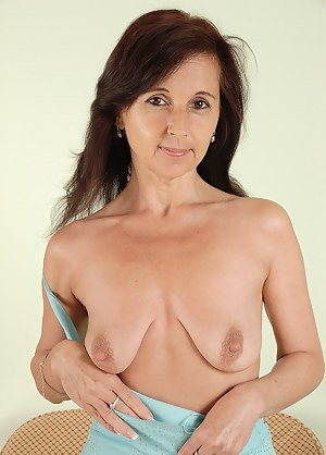 Mature and horny Jenny H from AllOver30 spreads her meaty pussy