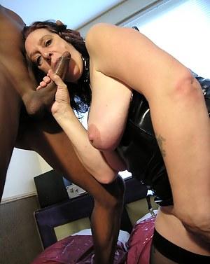 Horny mature slut having sex with a black dude