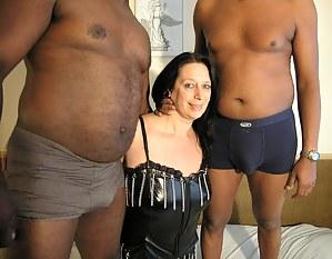 Horny mature slut doing two black dudes