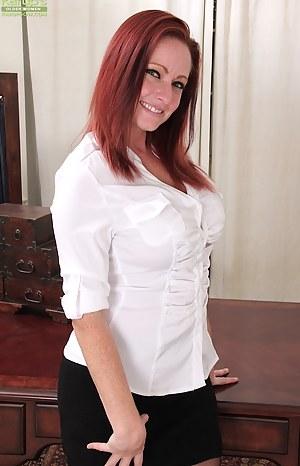 Redhead secretary Brandie Jones spreads MILF pussy on desk.