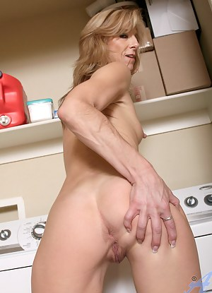 Attractive mature cougar shows off her elongated nipples in the laundry room