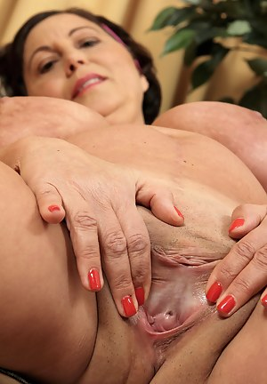 Sexy 52 year old Kata from AllOver30 lets her mammoth boobs free
