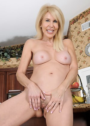 Sexy 60 year old housewife Erica Lauren getting naked in the kitchen