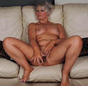 Naughty housewife masturbating on the couch