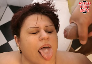 This chubby mature slut gets a cock on the toilet