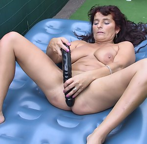 Kinky mature slut playing with toys in the garden