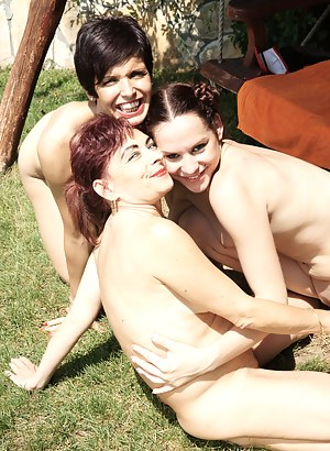 Three old and young lesbians enjoying the sun