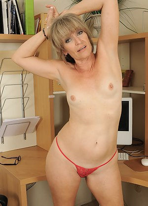 49 year old Tina from AllOver30 spreads her legs wide after work