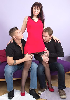 Naughty housewife fucking two guys at once